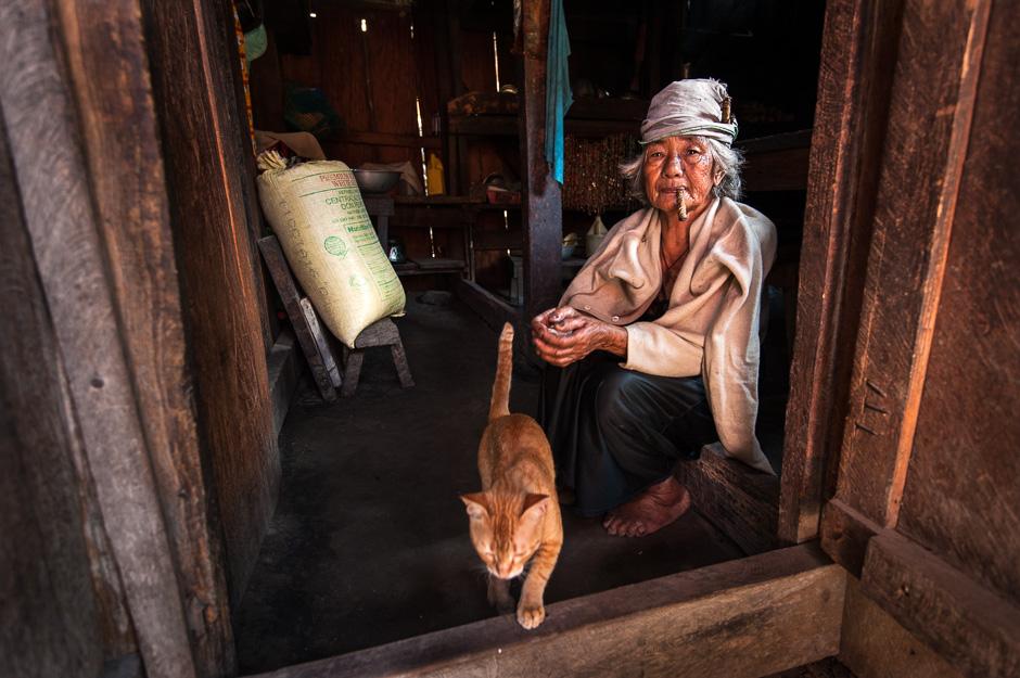 Tingguian Igorot woman in her home
