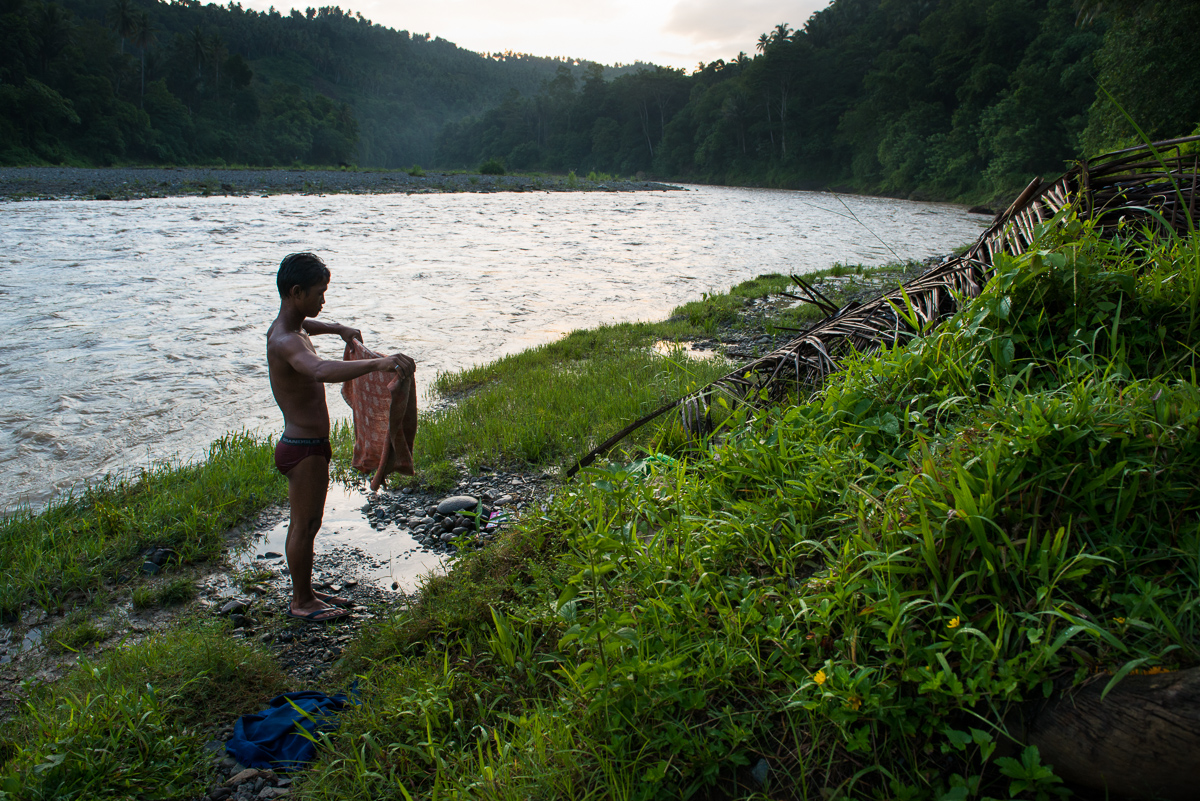 Mansaka taking early morning bath by the river