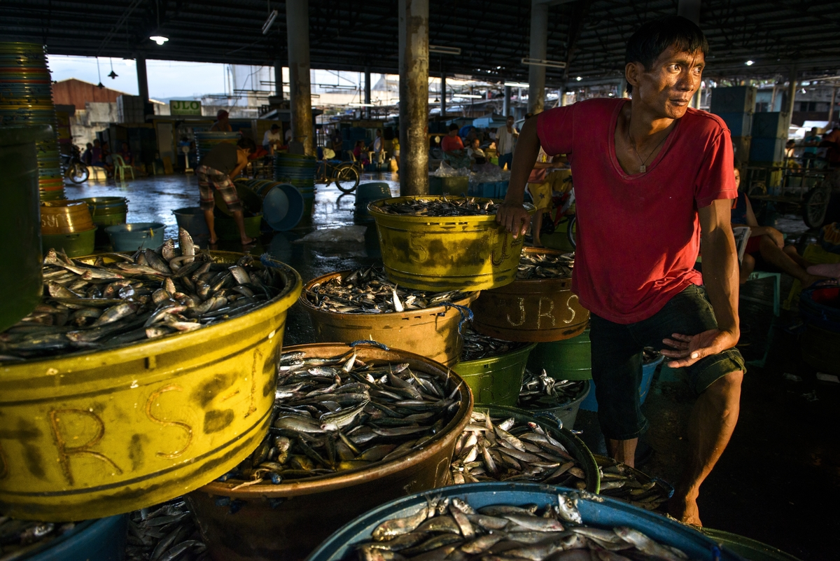 Fish vendor at the Pasil Fish market
