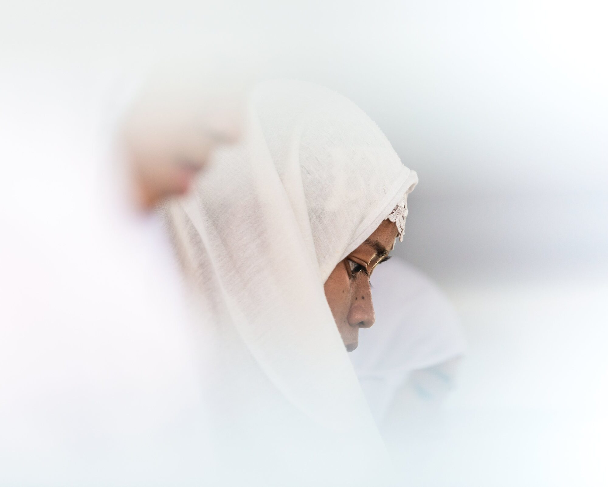 A Tausug woman during Friday prayer at a mosque in Bongao, the capitol of Tawi-Tawi. The majority of Tawi-Tawi's population is Muslim and belong to the Tausug or Sama-Bajau people.