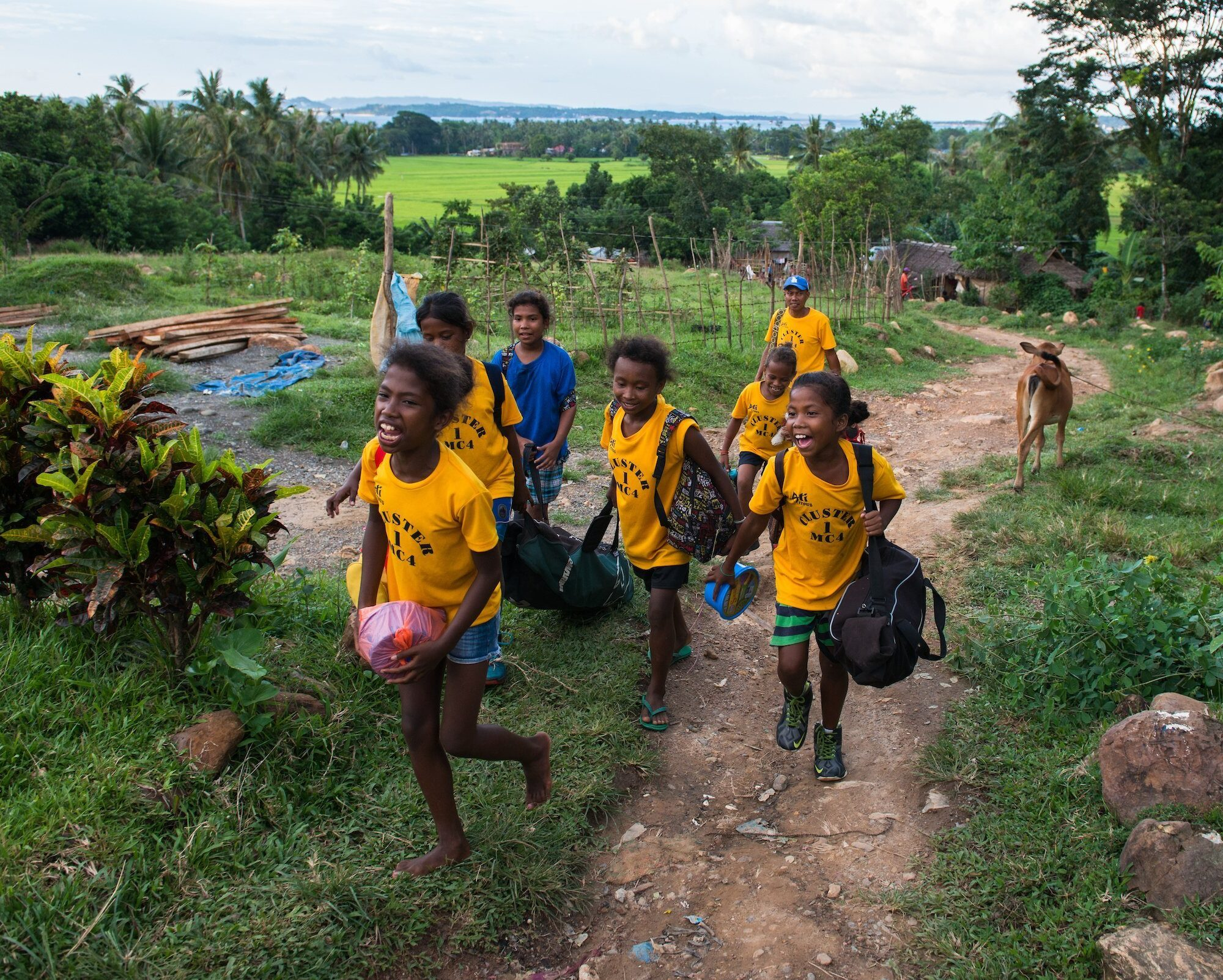 Ati girls arrive back in their village after competing in a local softball tournament. Many of the the indigenous Ati are now integrating more into typical Filipino/adapted western culture, especially the younger generation.