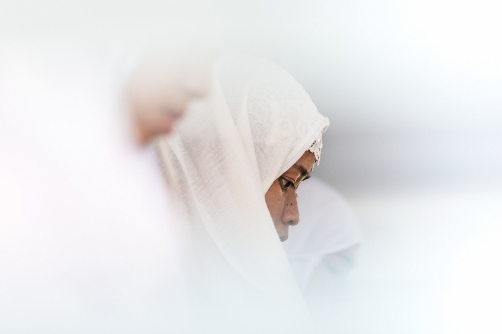 A Tausug woman during Friday prayer at a mosque in Bongao, the capitol of Tawi-Tawi. The majority of Tawi-Tawiís population is Muslim and belong to the Tausug or Sama-Bajau people.
